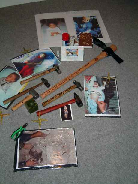 Hammers & photos of Iraqi's left at the scene of the disarmament at Shannon Airport Feb 2003